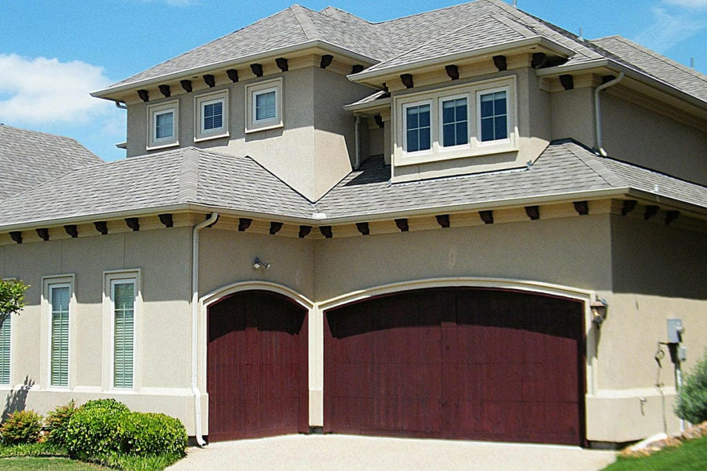 Two Story House with Offset 3 Car Garage and Red Garage Doors